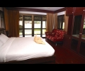 Master bedroom wth a king size bed and a sofa bed for 2. Private bathroom