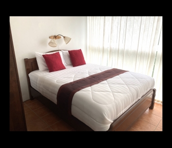 Bedroom with king size double bed, wardrobe and safe