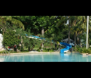 Water slide in big pool